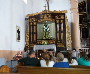 A major attraction is the 'Black Christ' in the church.  I didn't realize there could be multiple Christs, but people come from afar to worship this one!