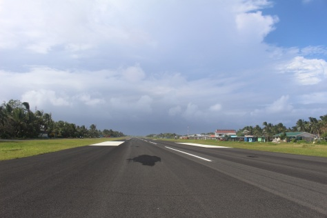 The runway was built by American troops during World War II. It is vital to the country, but unfortunately it occupies a large portion of the best land on the atoll, and other land was dug up for construction material. There is a project now to dredge sand from the lagoon and use it to fill the areas dug up.