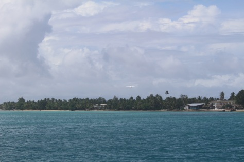 It's hard to photograph scenery at an atoll, since it is all flat. Here's the plane taking off -- three flights a week.