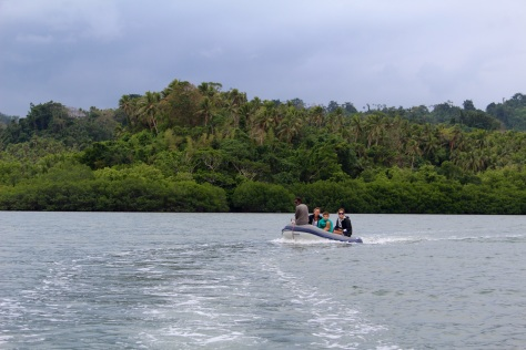 Two dinghies go exploring in the lagoon.