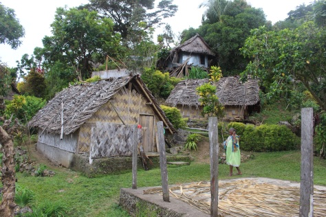 Village tour. Note elaborate bamboo woven siding.