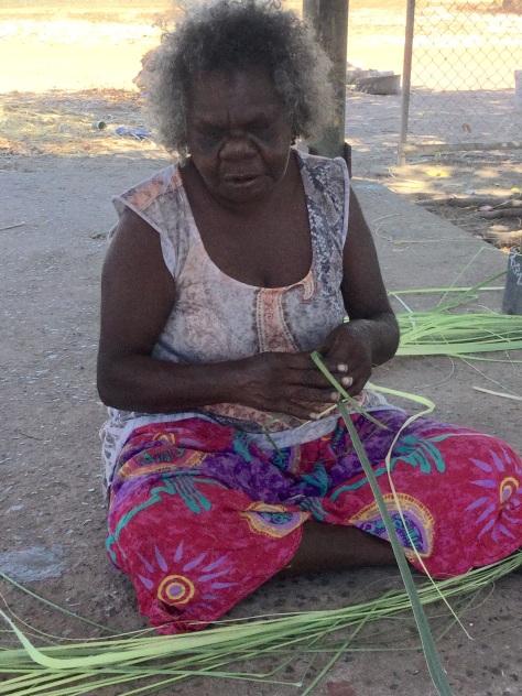 Preparing pandanus leaves for weaving.