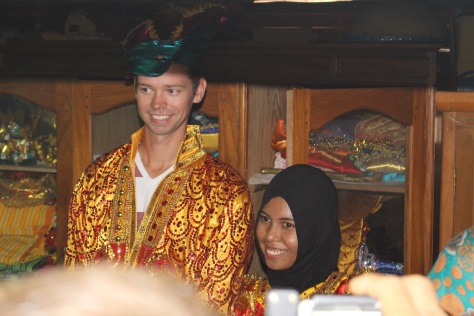 John models traditional wedding garb, with Ulhy as his bride.