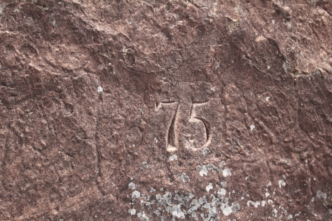 The 75th Regiment was encamped here, charged with blowing up passes used by the Bushmen and others with their cattle. The cook was apparently bored, and carved this 75 into the rock.