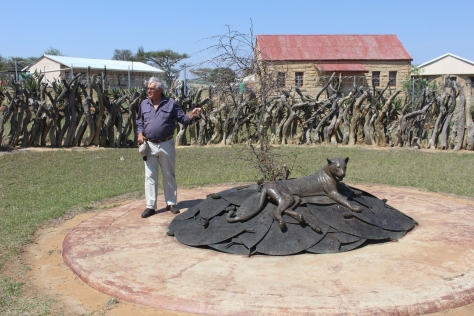 Greg explains the symbolism of a memorial to the many Zulus killed at Rorke's Drift.