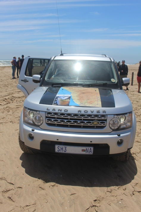 Our vehicle, with a map of Namibia on the hood.