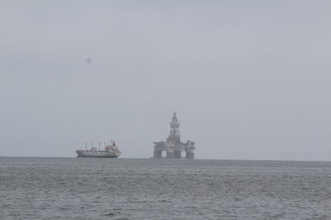 Leaving Walvis Bay; several oil rigs anchored in the harbor, waiting for the price of oil to go up, to make it worthwhile redloying them.
