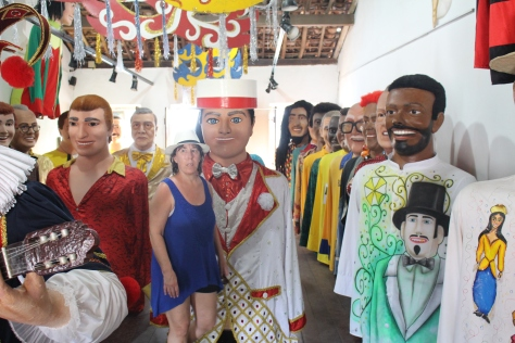 We walked into a little gallery/cafe, and learned that upstairs they store the giant puppets used at Carnival...